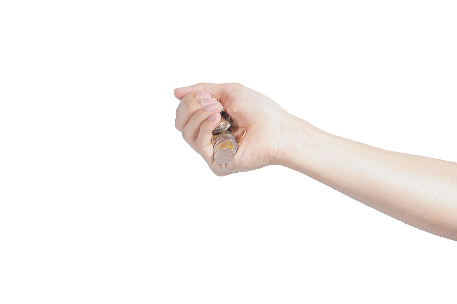 monete che cadono da una mano foto
