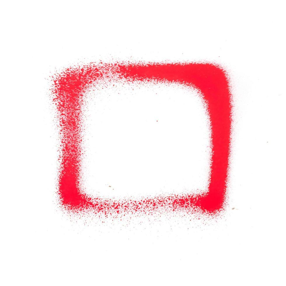 rosso brillante vernice spray texture su sfondo bianco foto