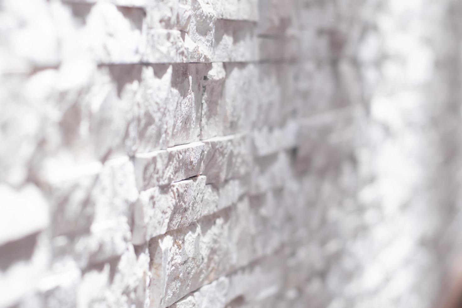 muro di mattoni bianco e nero foto