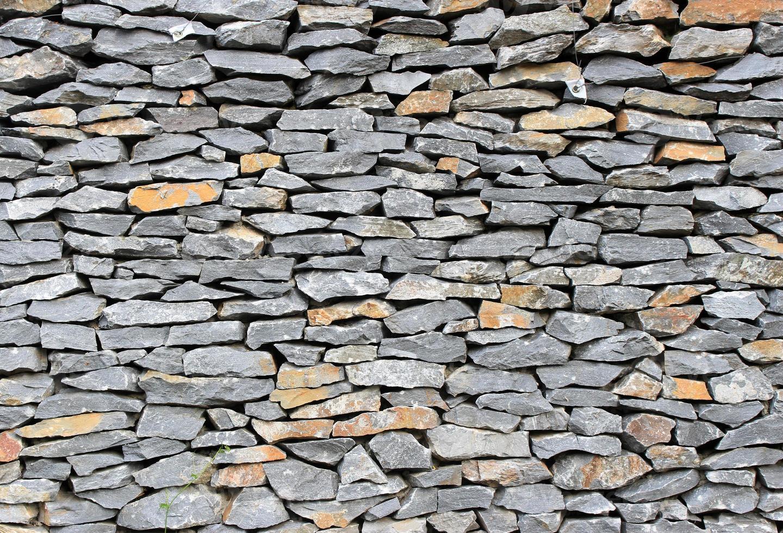 superficie dello sfondo muro di pietra foto