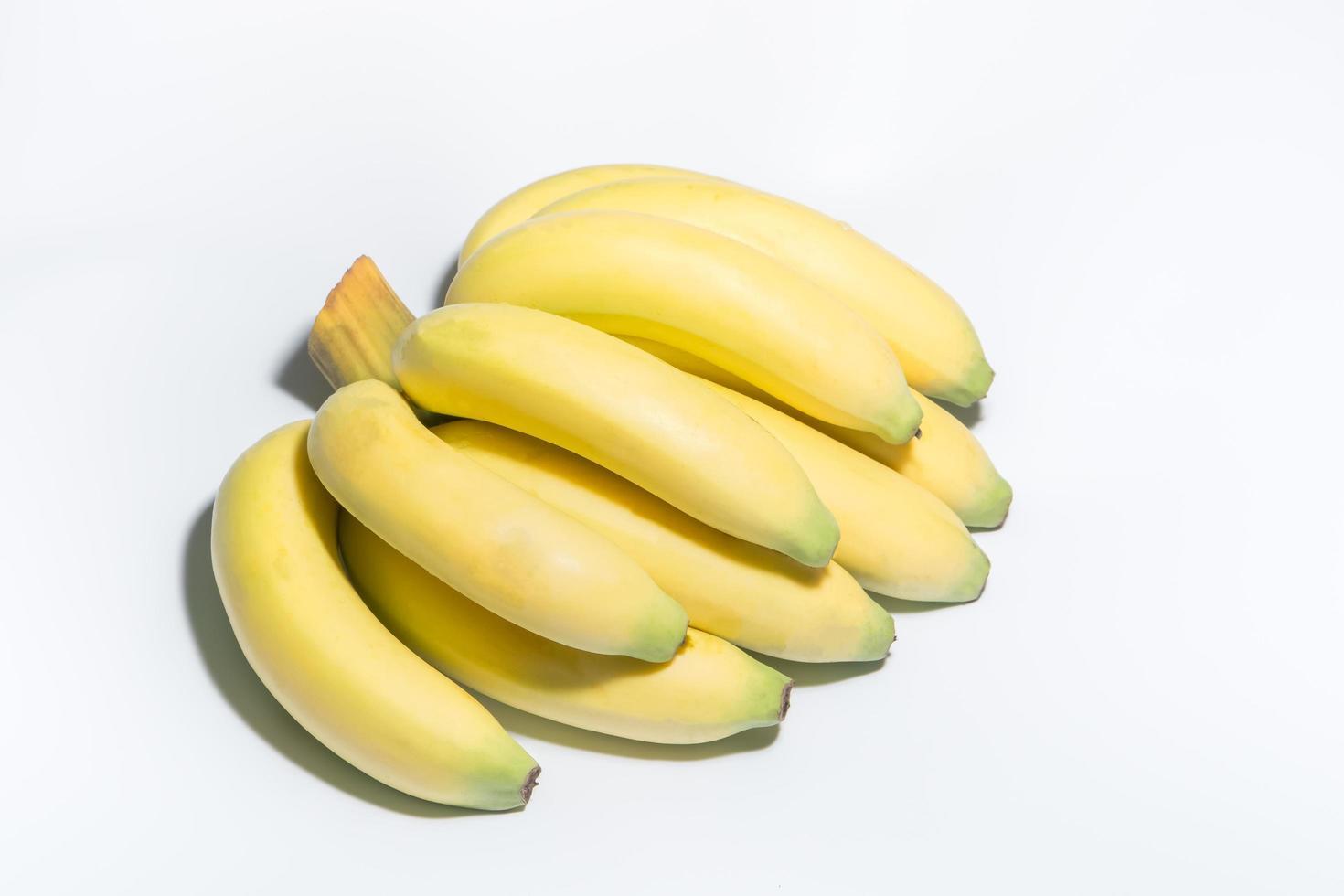 banane su sfondo bianco foto