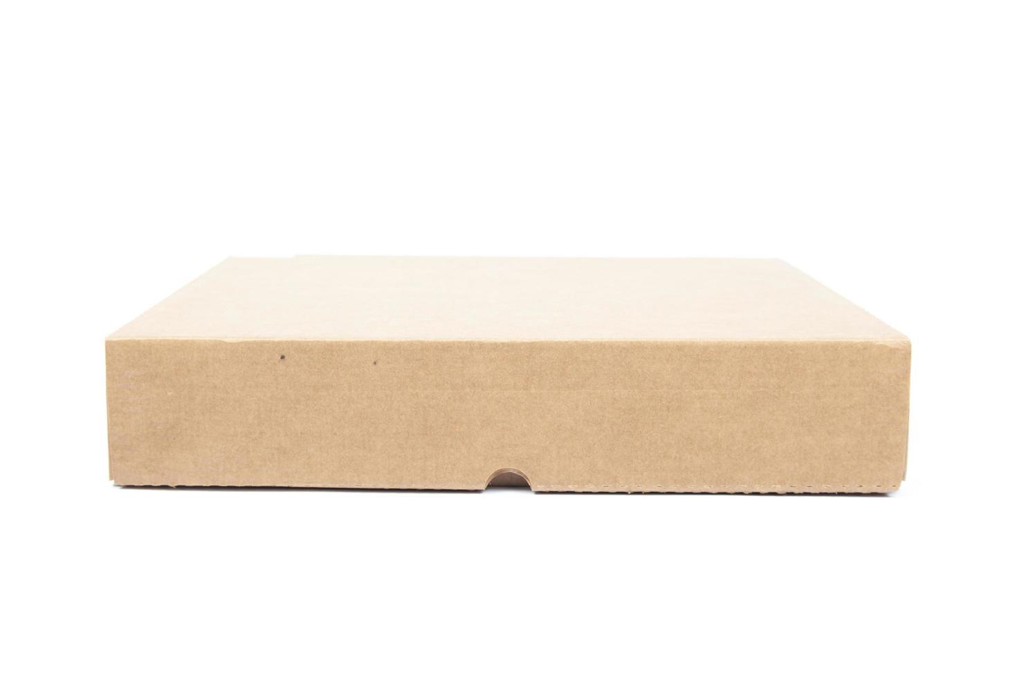 scatola di carta marrone su sfondo bianco foto