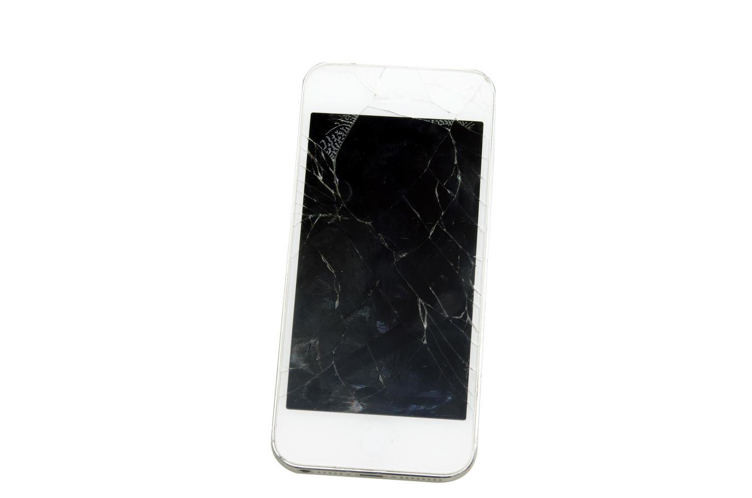 schermo del telefono rotto su sfondo bianco foto