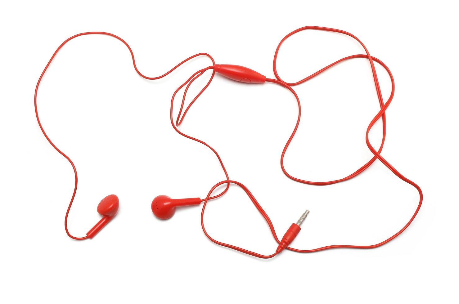 auricolari rossi su sfondo bianco foto