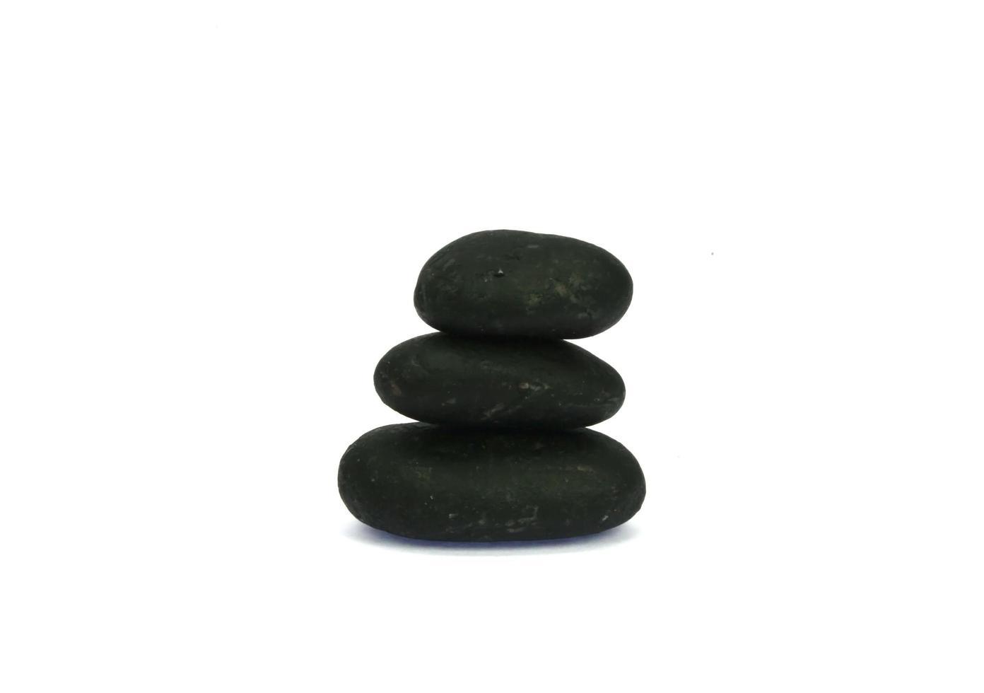 pila di pietre nere foto