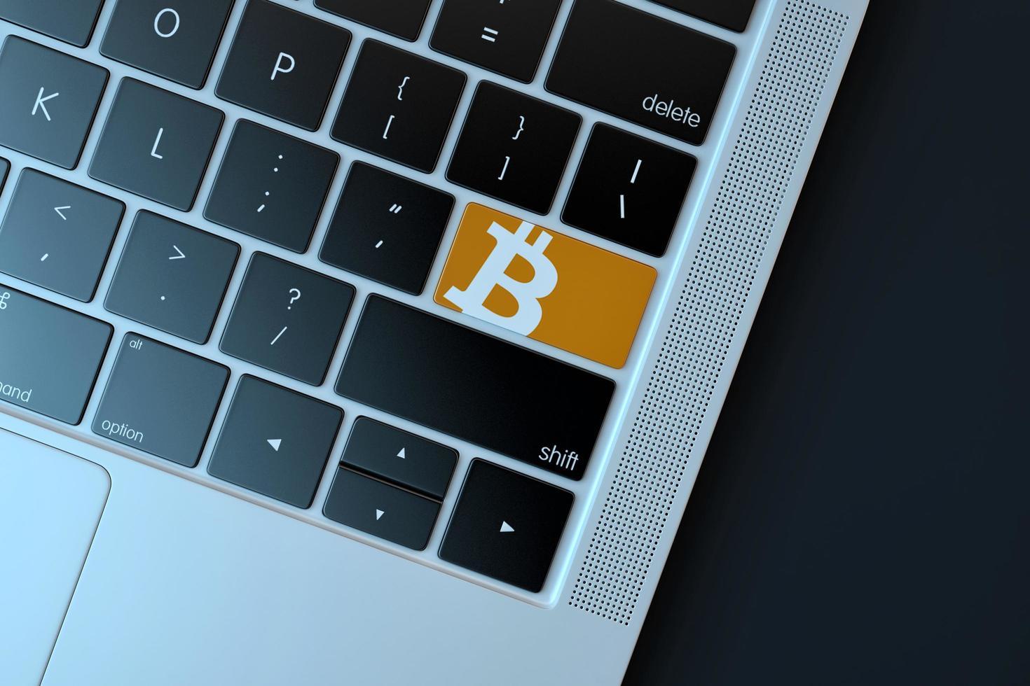 2018-- editoriale illustrativo dell'icona bitcoin sulla tastiera del computer foto