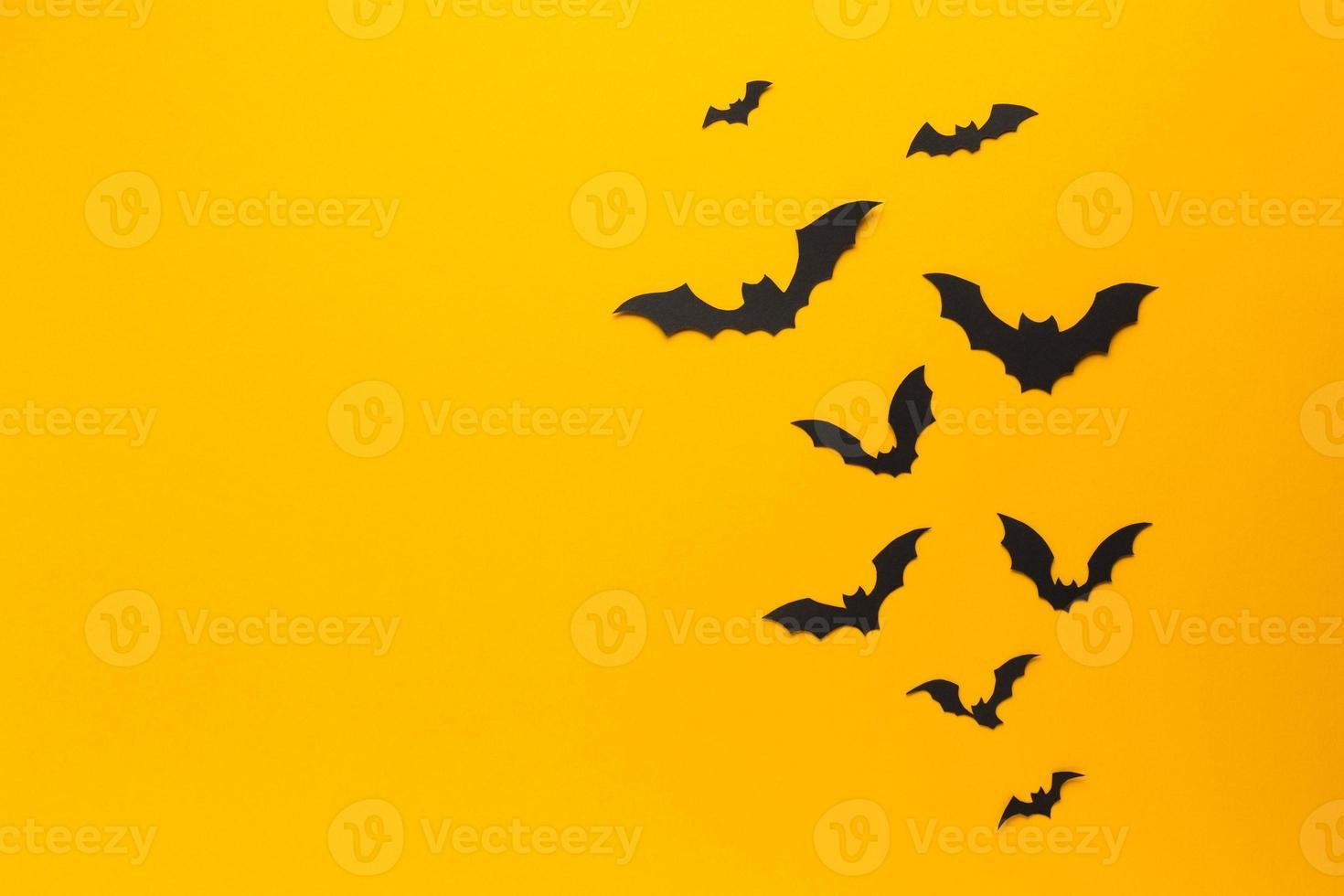 pipistrelli di Halloween con sfondo arancione foto
