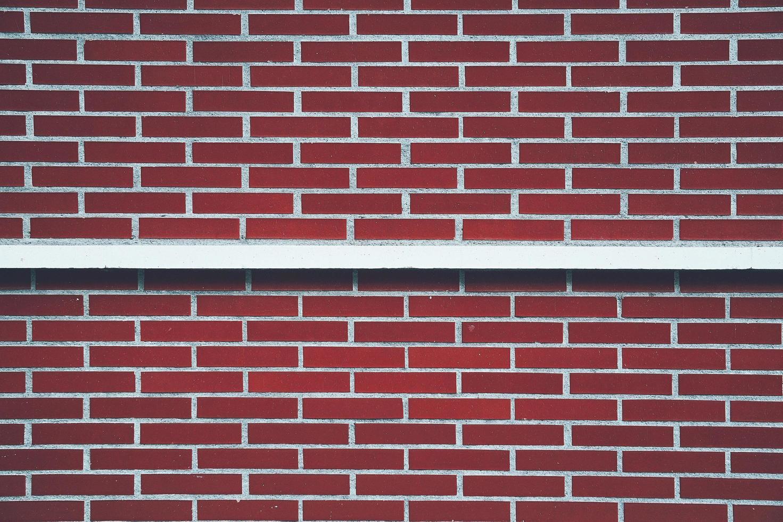 facciata di edificio vecchio muro rosso foto