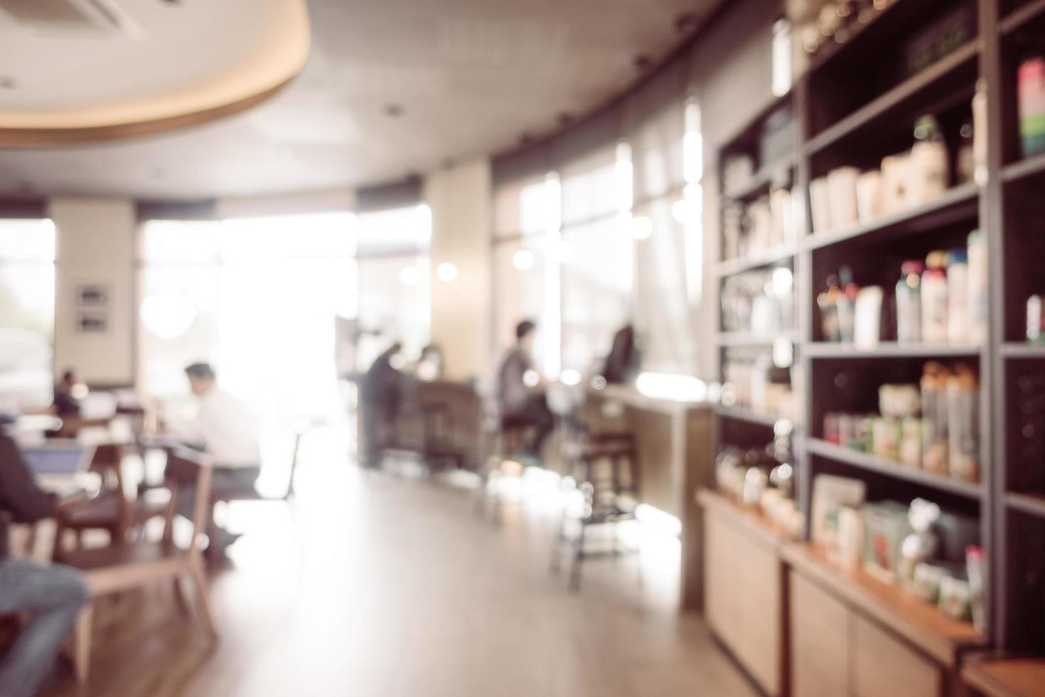 sfocatura astratta caffetteria e ristorante interno foto