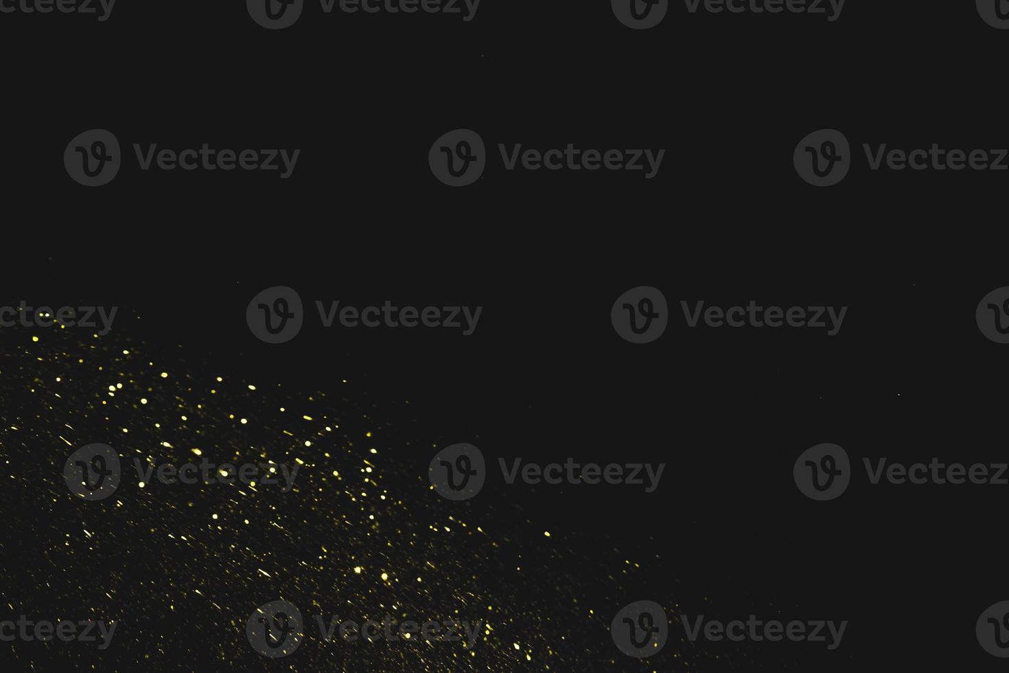 paillettes gialle su sfondo scuro foto