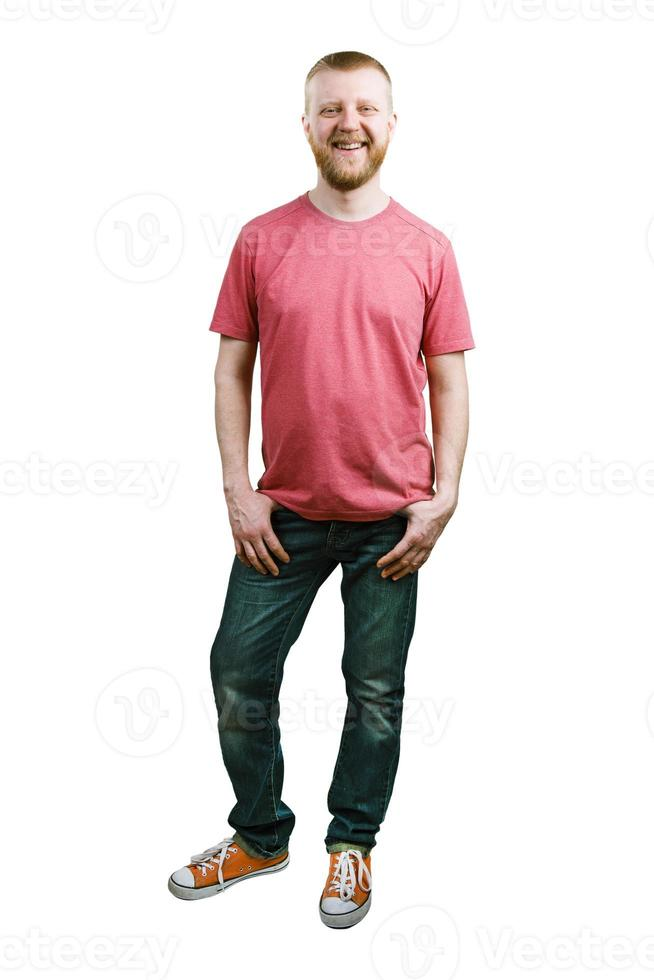 giovane barbuto in maglietta e jeans foto