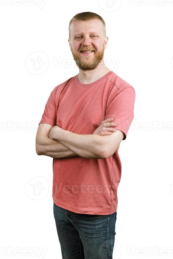 uomo barbuto felice in camicia e jeans foto