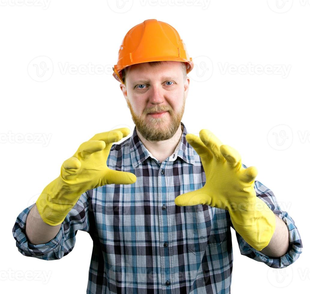 uomo con casco e guanti di gomma gialli foto