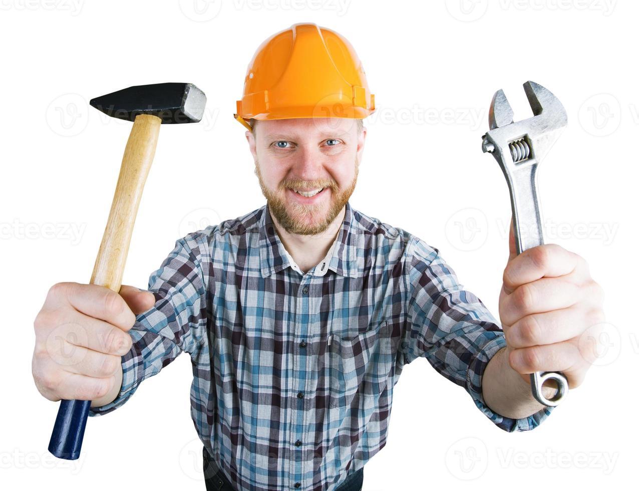uomo con l'elmo con martello, chiave inglese foto