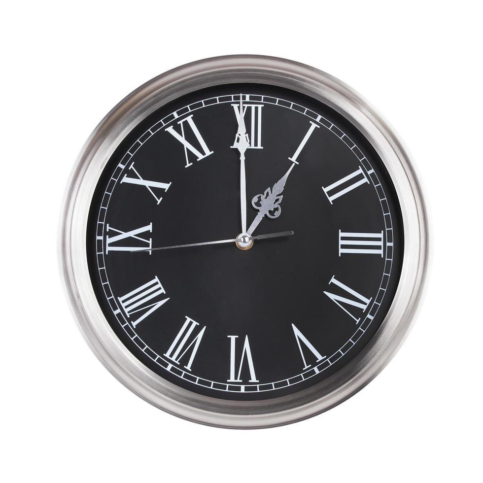 esattamente un'ora con l'orologio rotondo foto