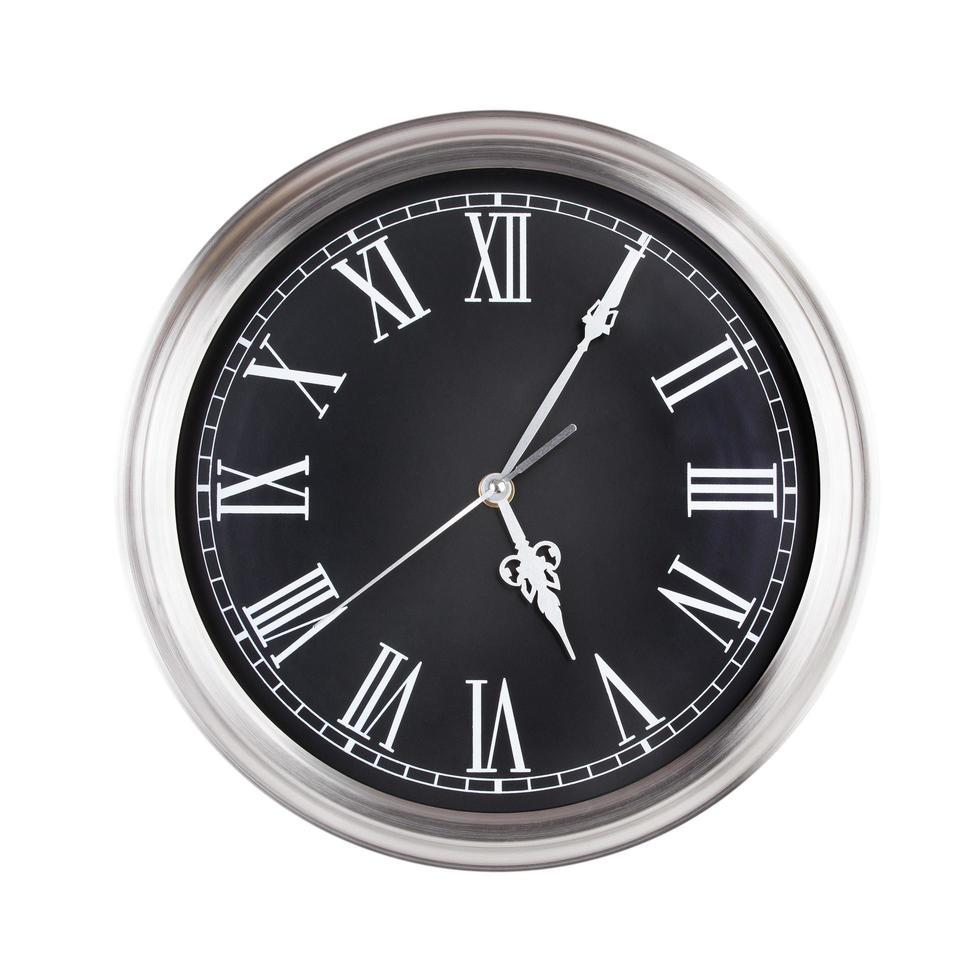 le cinque e cinque dell'orologio foto