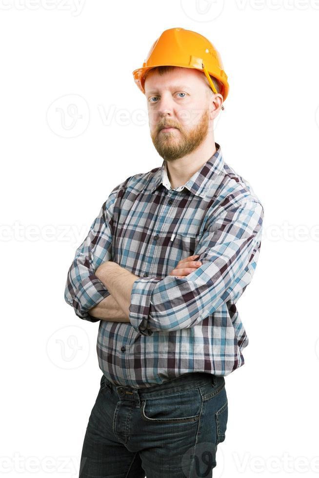 uomo con un casco da costruzione arancione foto