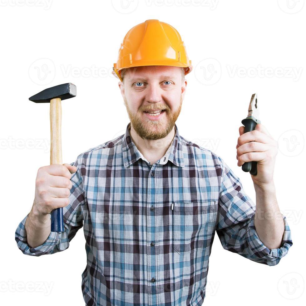 uomo con un elmo con un martello e una pinza foto