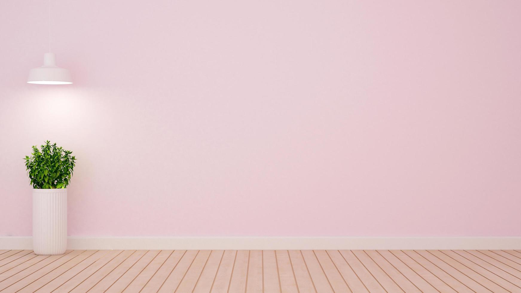 pianta e lampada a sospensione in una stanza vuota su tonalità rosa chiaro foto