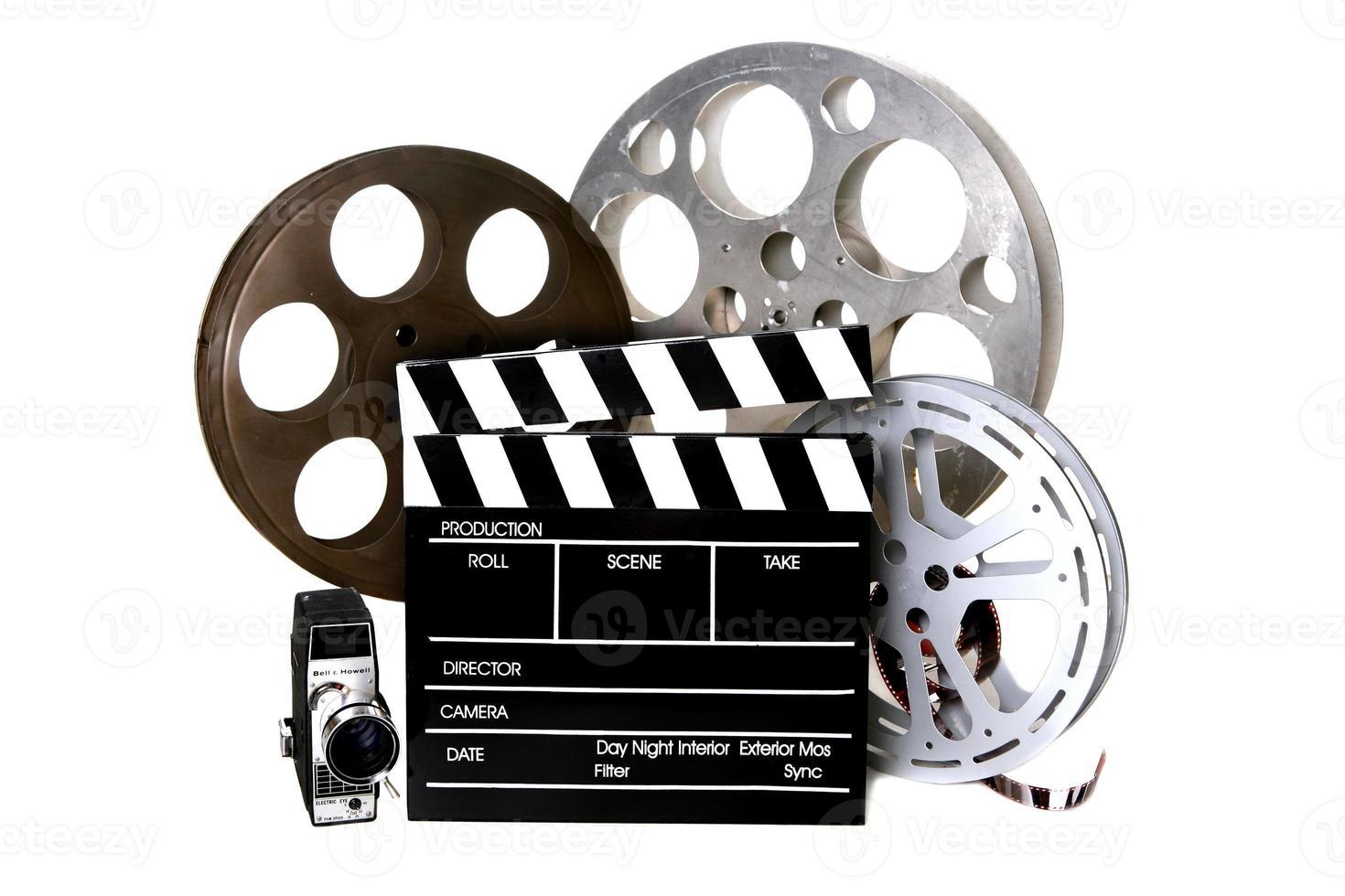 bobine di film e registi batacchio con macchina fotografica d'epoca foto
