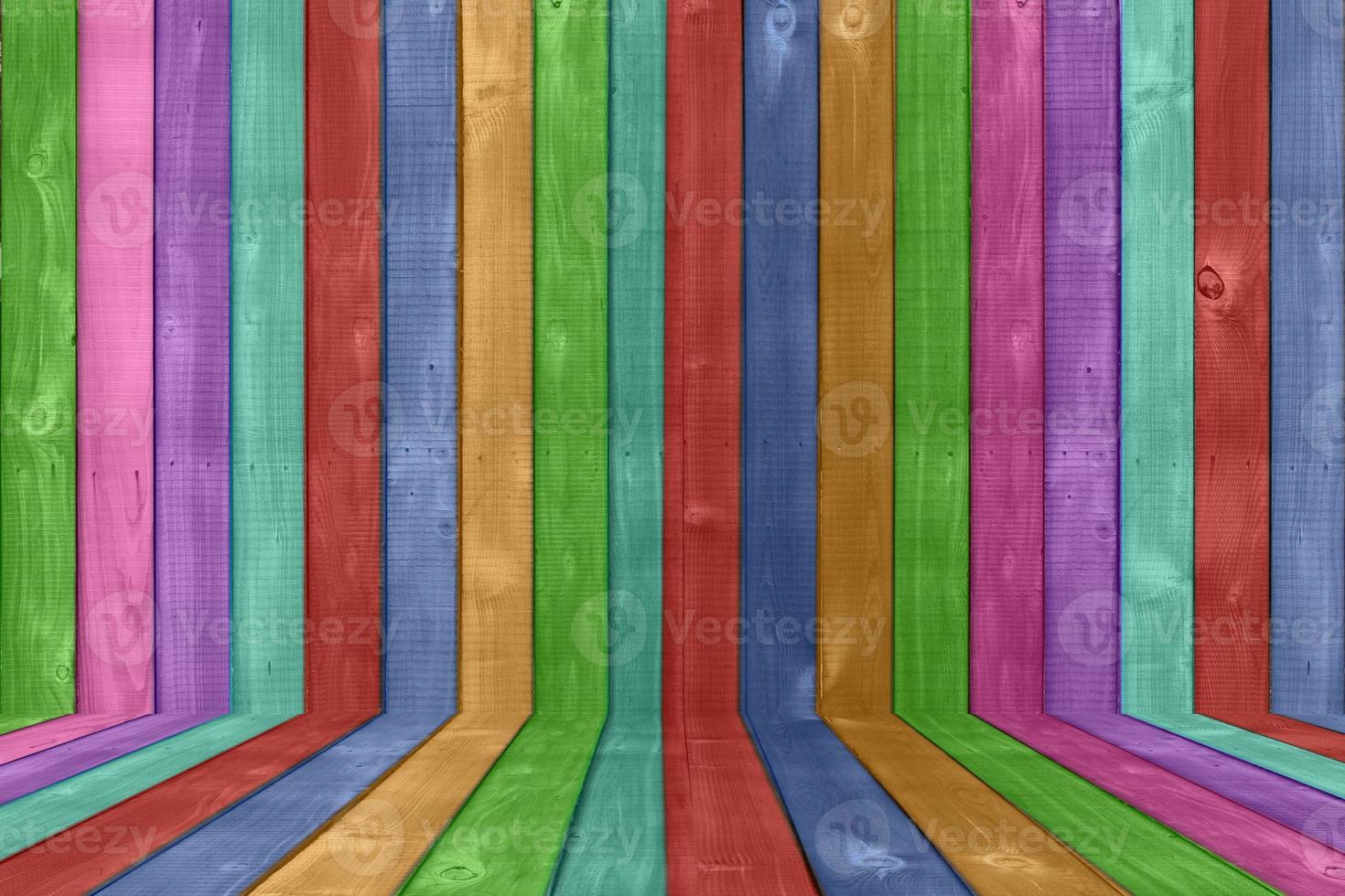 sfondo di recinzione in legno dai colori vivaci foto