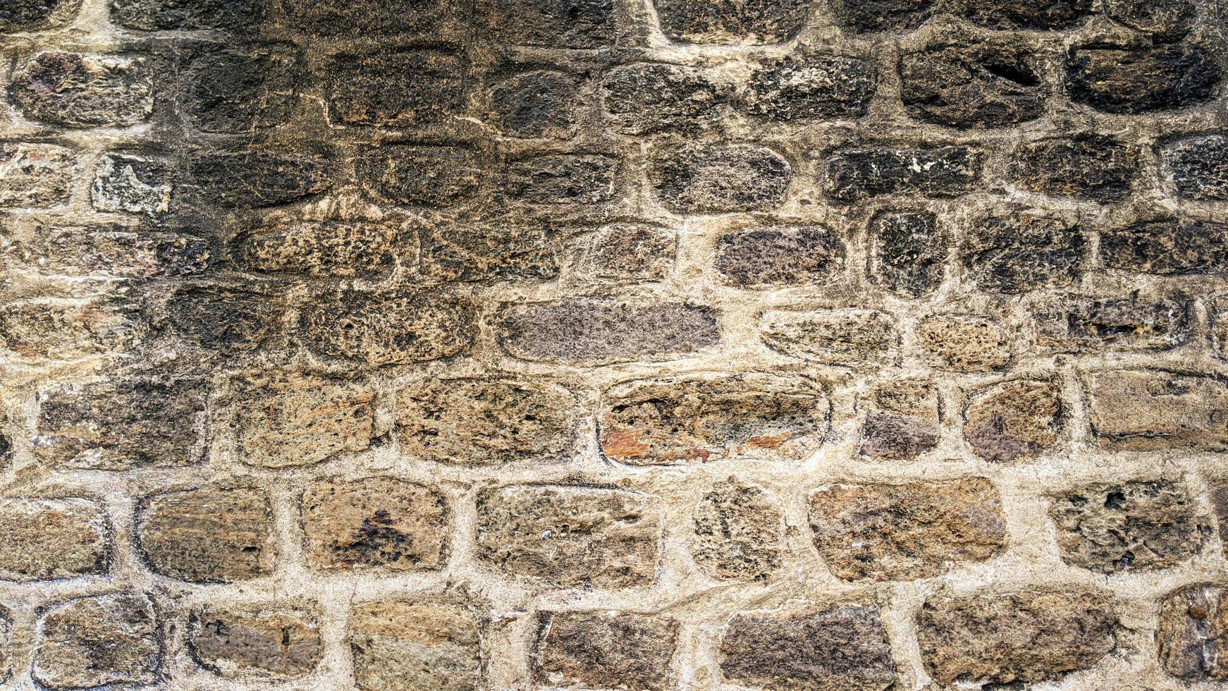 trama di sfondo del vecchio muro di pietra foto