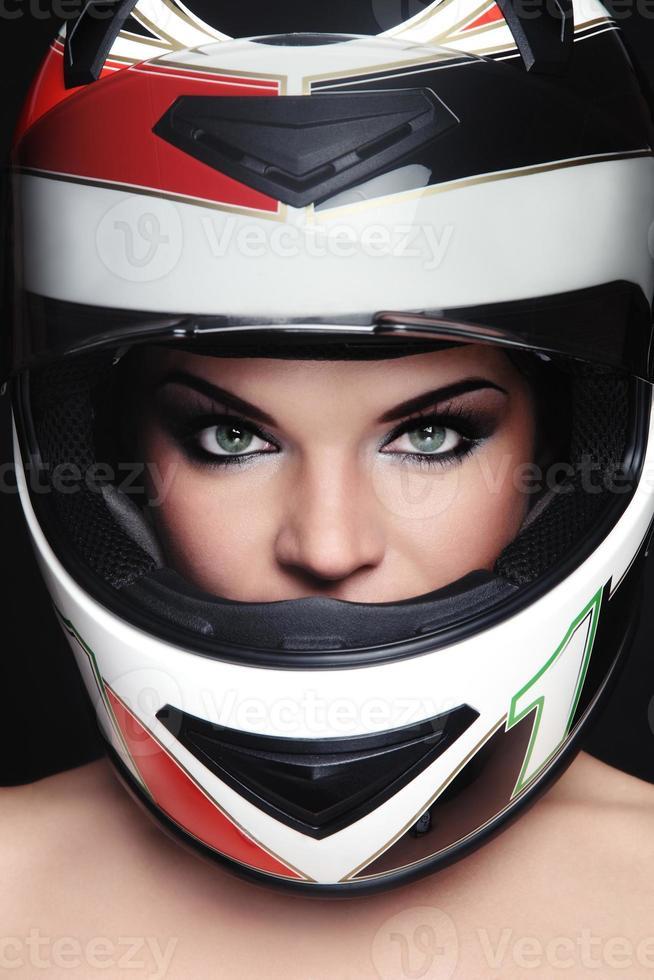 donna nel casco del motociclista foto