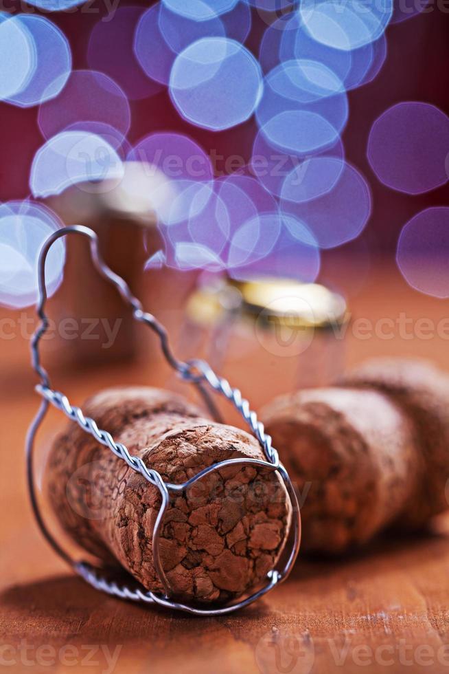 champagne corcks su sfondo sfocato foto