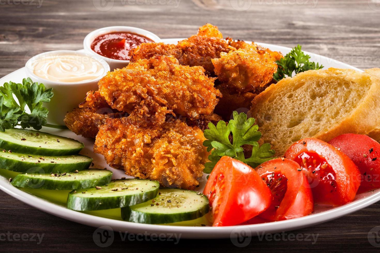 bocconcini di pollo e verdure foto