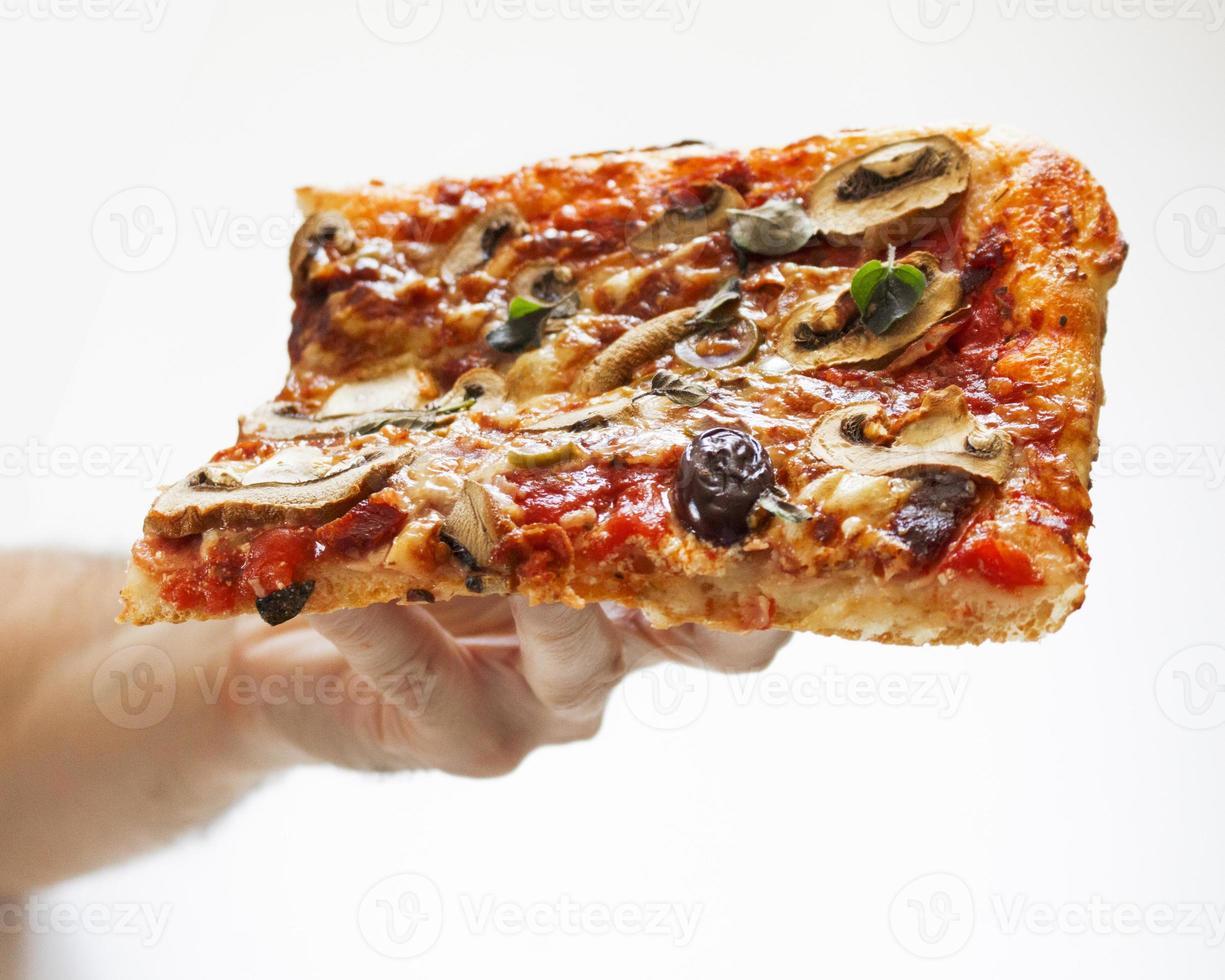 mangiare la pizza foto