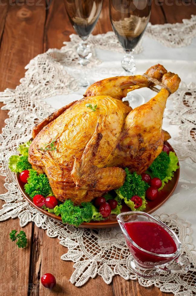 pollo arrosto con salsa di mirtilli rossi foto