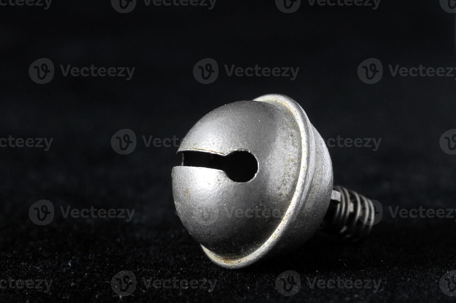piccola campana vintage in metallo foto