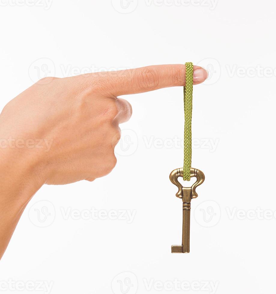 mano con chiave vecchia foto