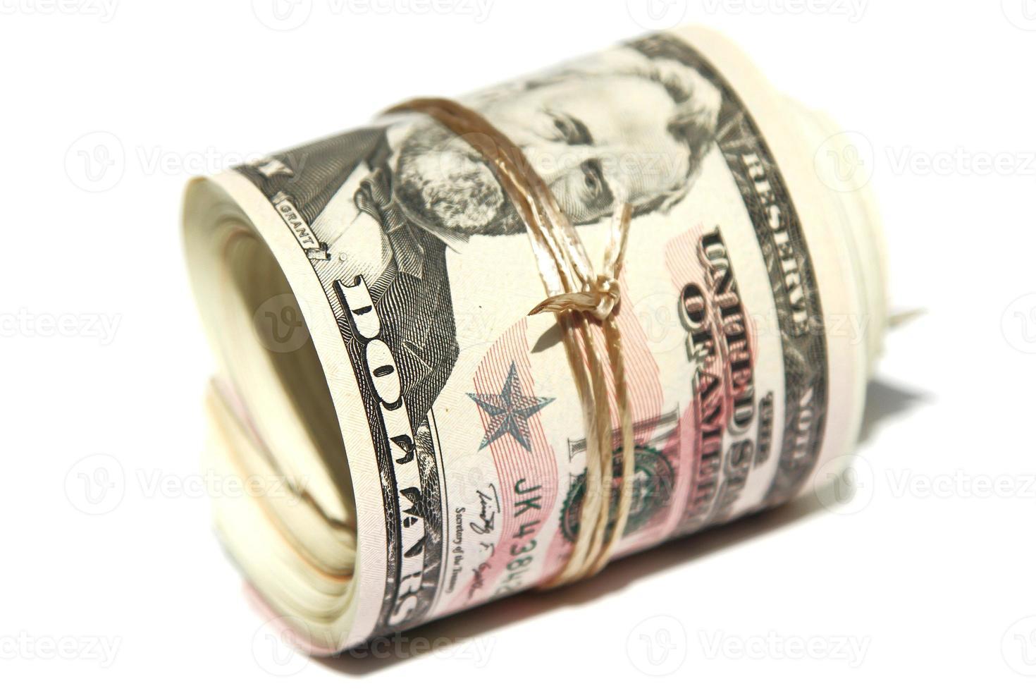 banconote da un dollaro rotolate foto