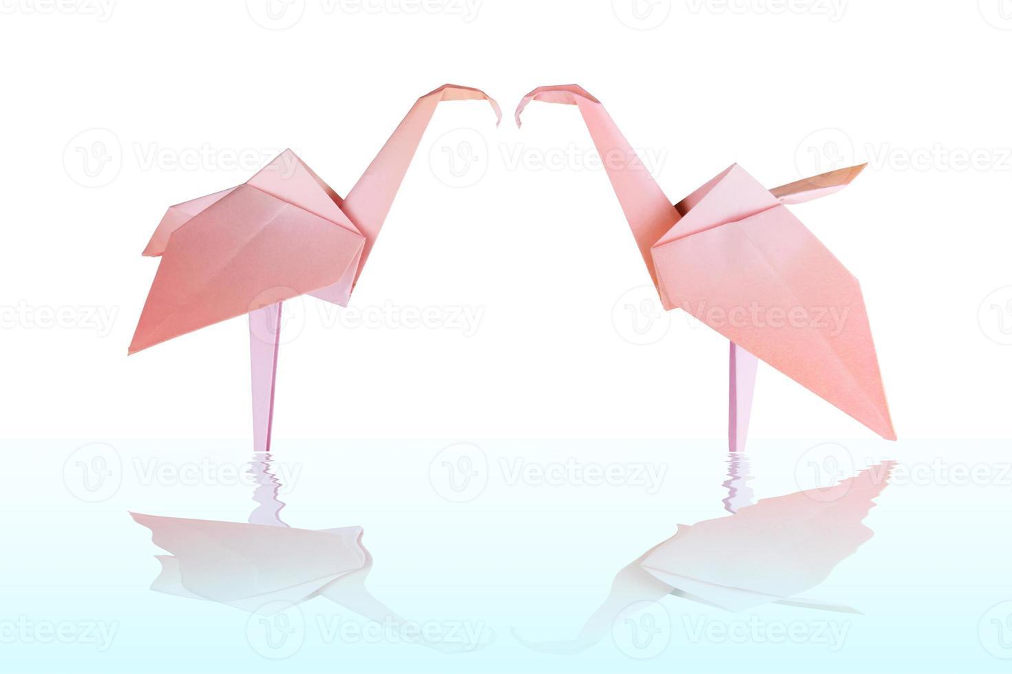 coppia di fenicotteri di carta rosa origami foto