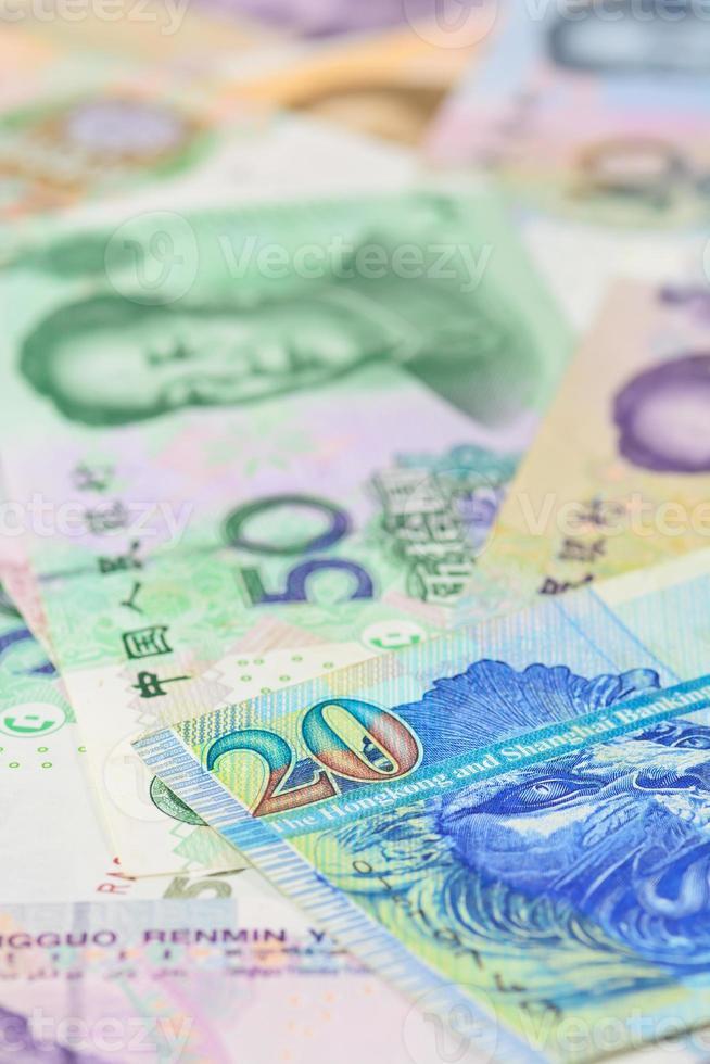 Dollaro di Hong Kong e yuan cinese banconote, per il concetto di denaro foto