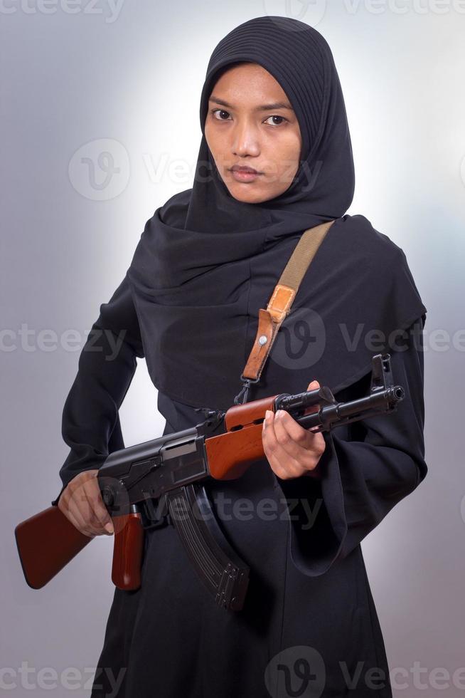 donna con una mitragliatrice foto
