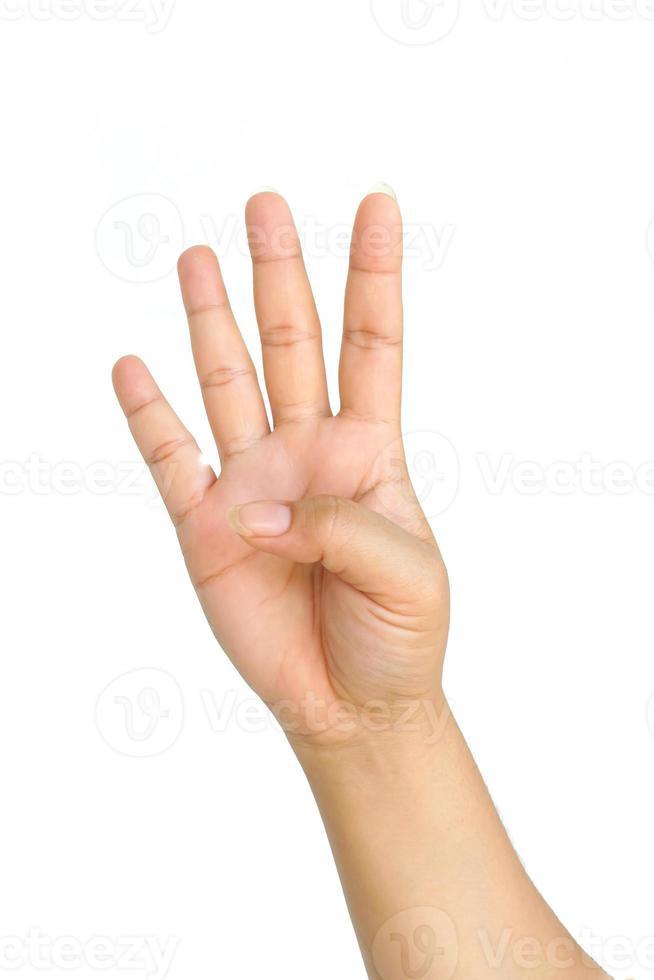 mano che mostra quattro dita foto