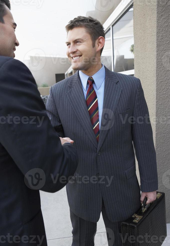 uomini d'affari nella riunione d'affari foto
