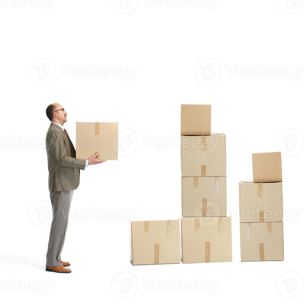 uomo d'affari e scatole di cartone foto