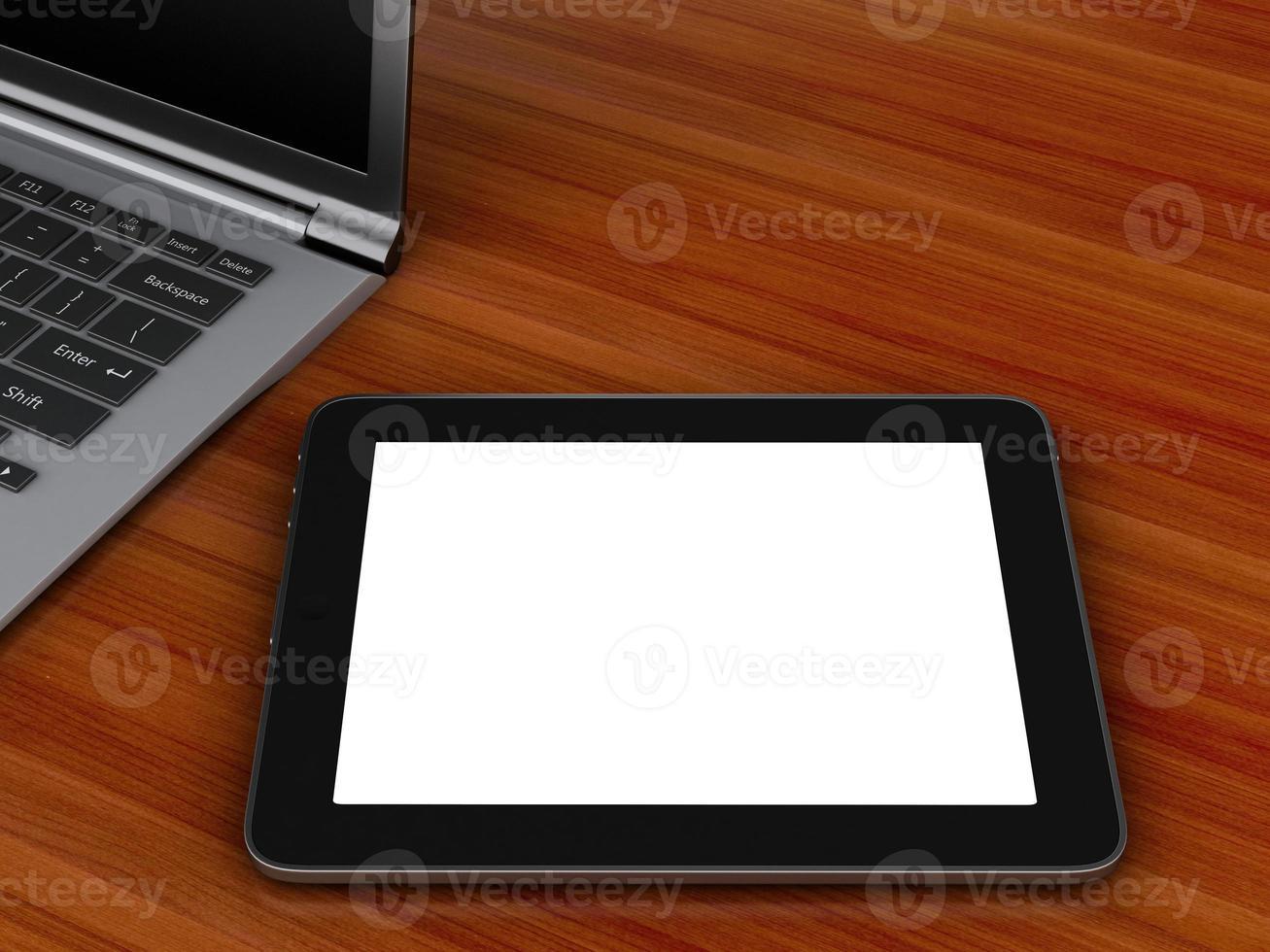 posto di lavoro con tablet digitale e pc portatile. foto