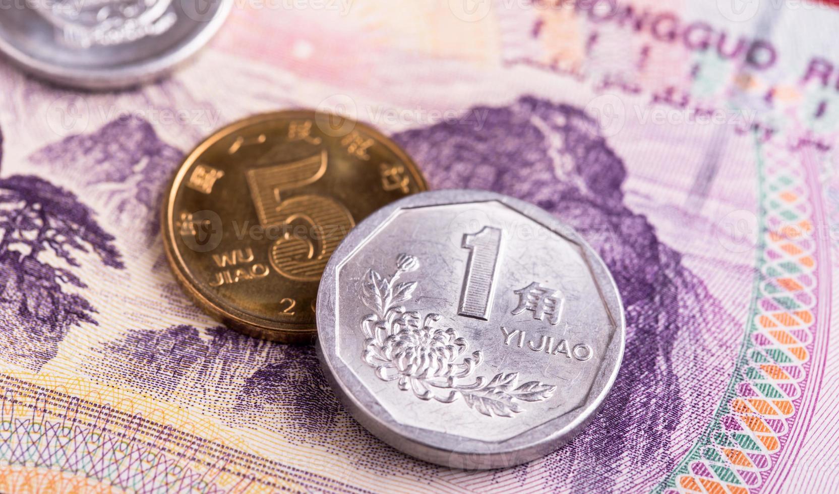 monete e banconote cinesi di yuan foto