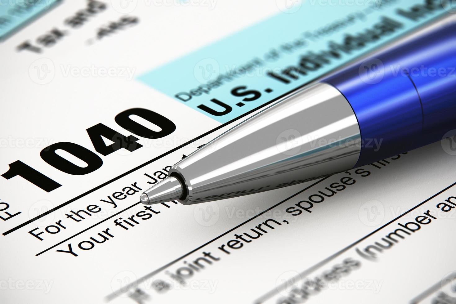 il 1040 us modulo di dichiarazione dei redditi individuale e penna a sfera foto