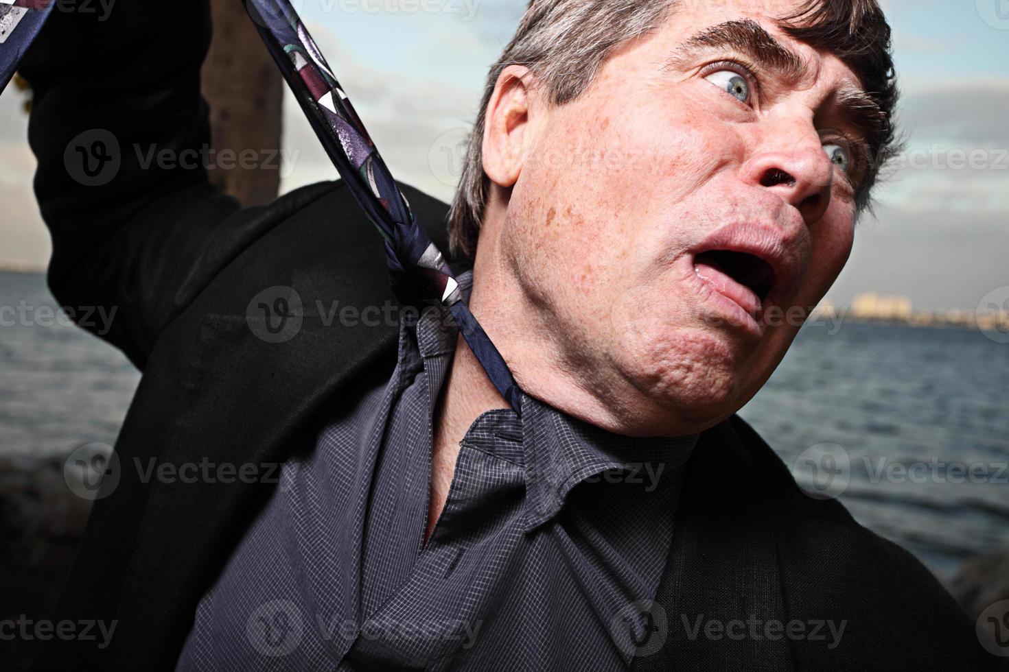 uomo d'affari soffocante foto