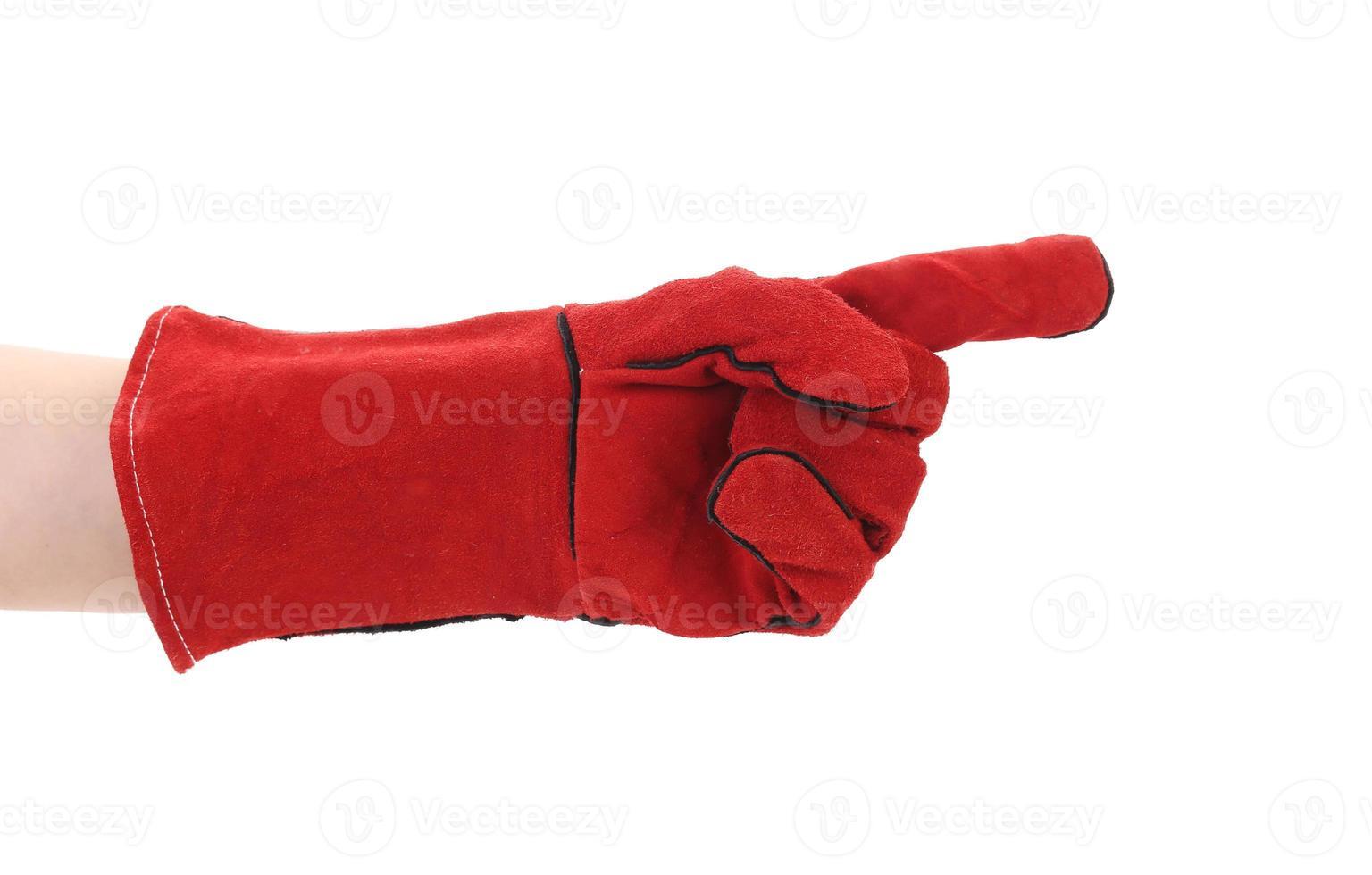 dito puntato in guanto rosso. foto