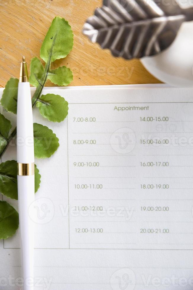 pagina vuota dell'appuntamento con la penna foto