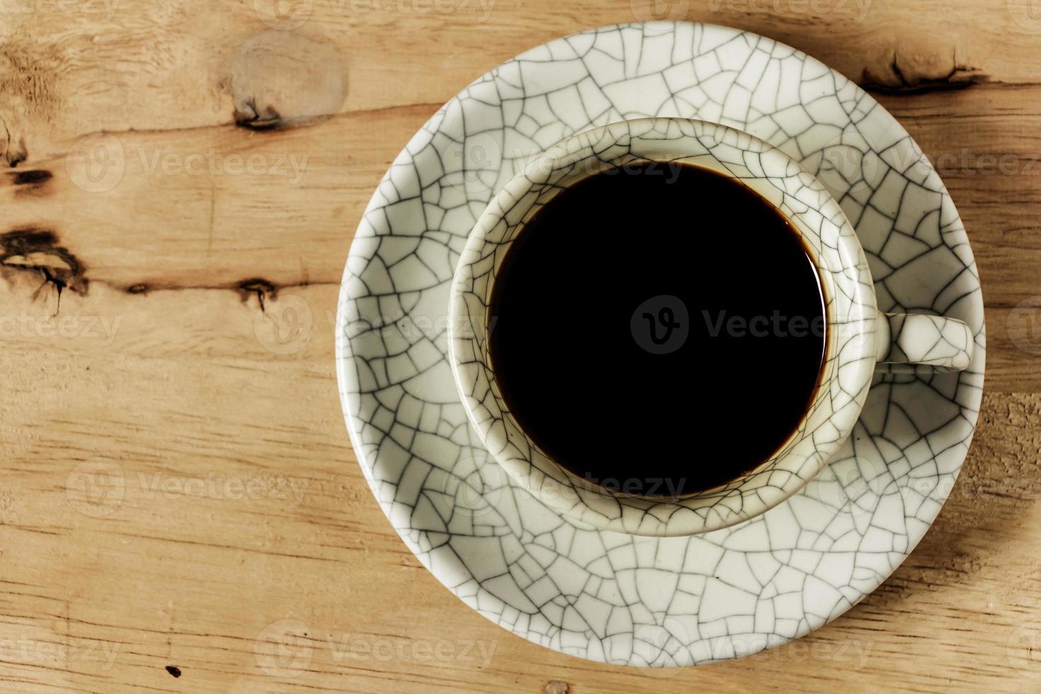 tazza di caffè sul tavolo di legno con spazio di copia. foto