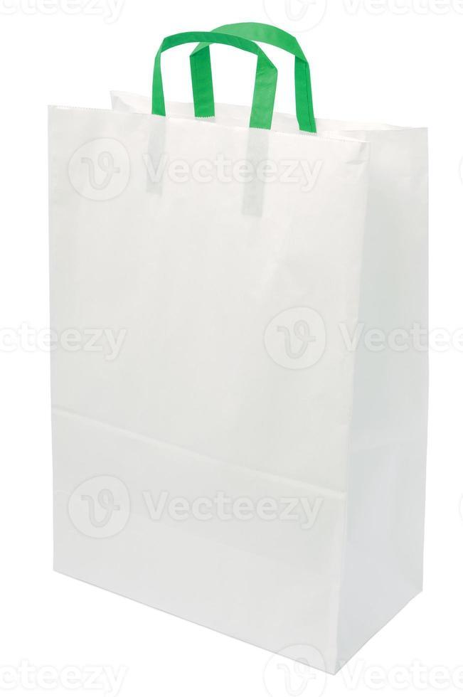 sacchetto di carta bianco, maniglie verdi, shopping spazio isolato closeup copia foto