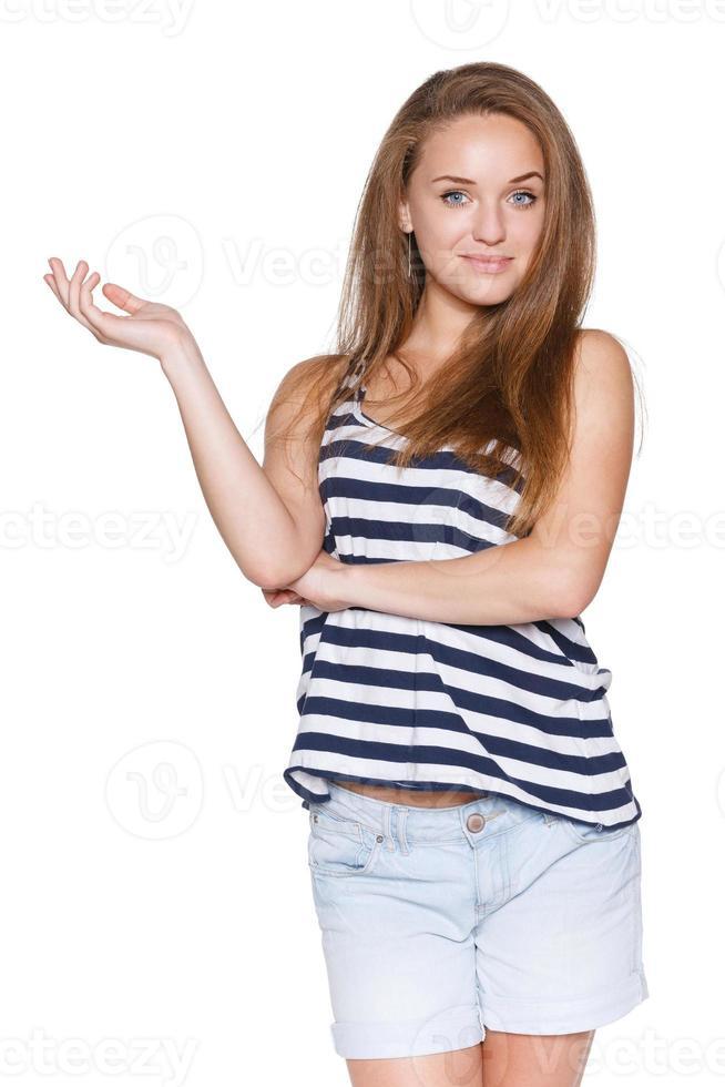 pantaloni a vita bassa della ragazza dell'adolescente che mostrano lo spazio in bianco della copia foto