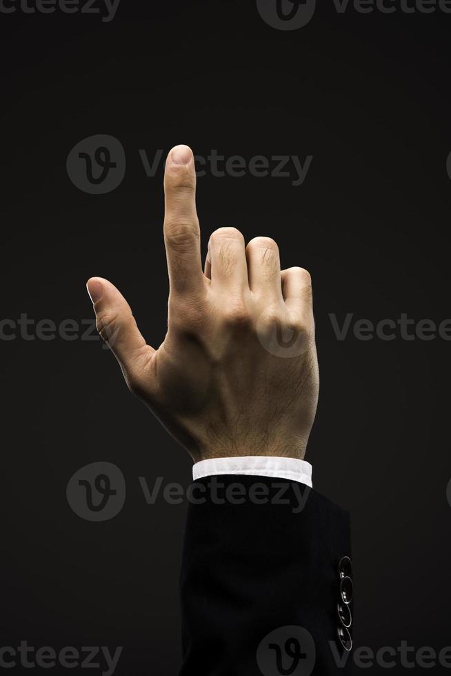 dito di uomo d'affari mano che punta foto